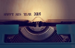 closeup of a yellowish paper with the text happy new year 2016 in an old blue typewriter